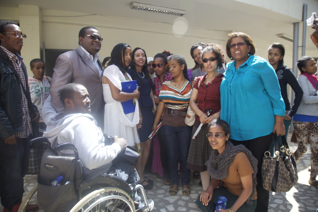 Haben and Aster posing with disabled students at Addis Ababa University.