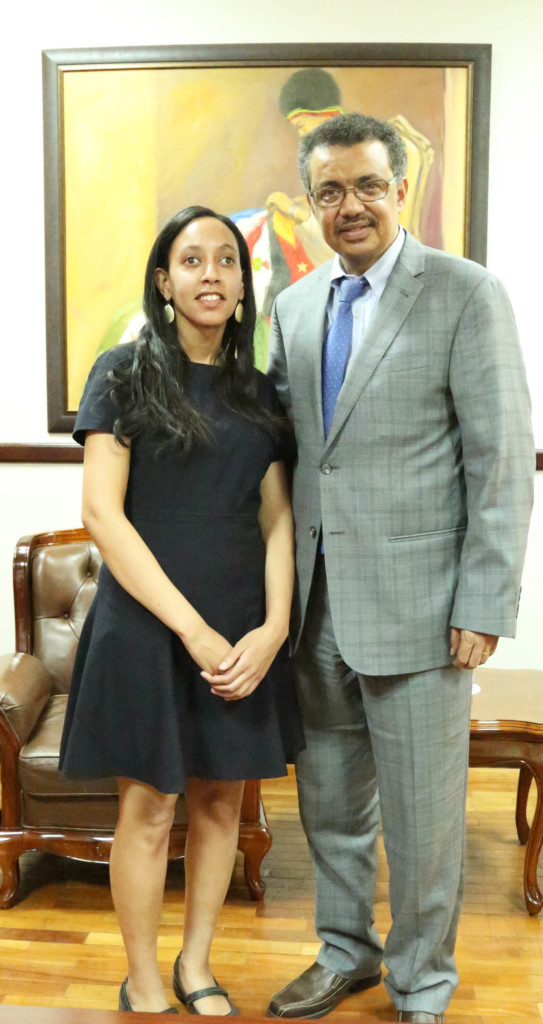 Haben and Dr. Tedros Adhanom posing in front of painting at the Ministry of Foreign Affairs.