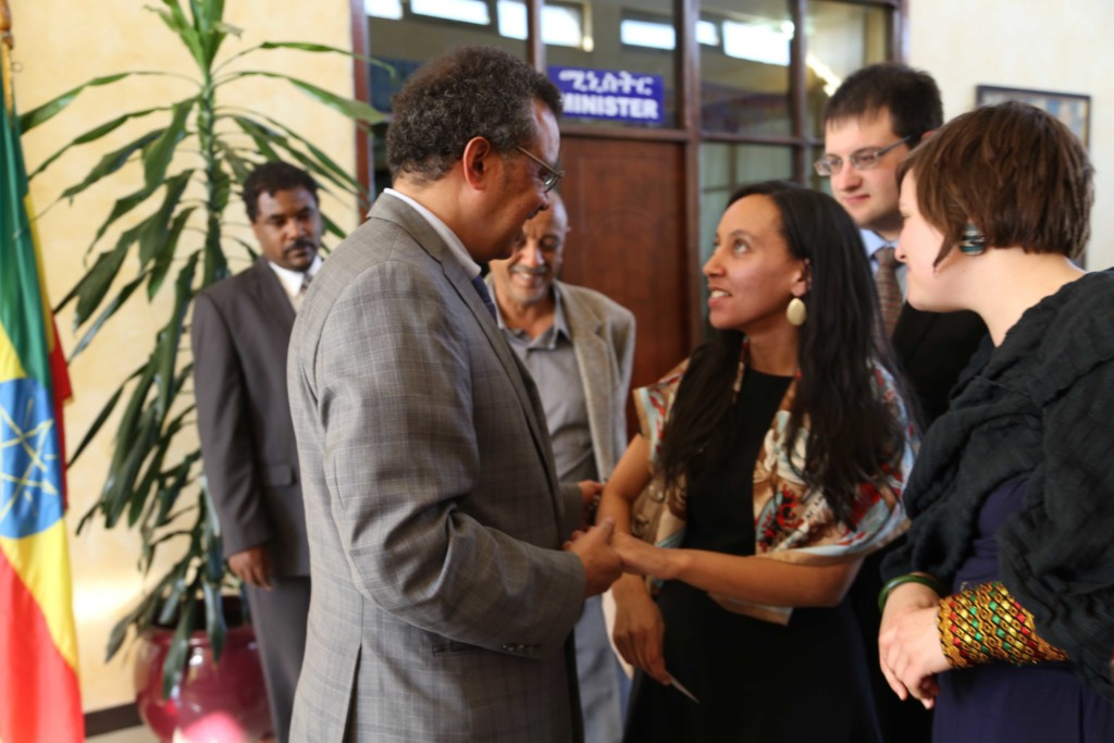 Haben shaking hands with Dr. Tedros Adhanom at the Ministry of Foreign Affairs.